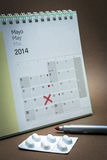Control pills on a calendar Royalty Free Stock Images