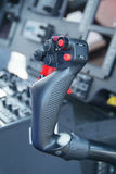 Control stick of helicopter. Cyclic control stick of large passenger helicopter. Shallow depth of field, with only the stick in focus Stock Photo
