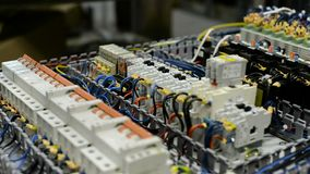 Control system of a modern CNC machine. Electrical modules and cables are mounted on the circuit board stock video footage