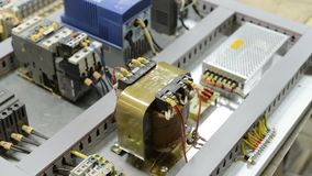 Electrical modules, switches, relays and cables are mounted on the circuit board. Control system of a modern CNC machine. Electrical modules, switches, relays stock footage