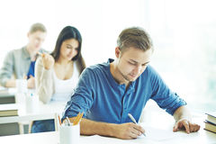 Control test. Students writing test in college Royalty Free Stock Photo