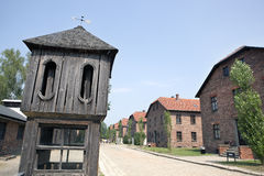 Control tower and barracks in Auschwitz camp. Wood control tower and group of prisoner barracks in Auschwitz concentration camp Royalty Free Stock Image
