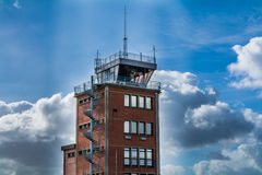 Control tower over dramatic sky. Royalty Free Stock Photos