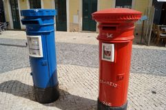 The Portuguese mailboxes have to appear among the most visible of the world !. Control towers red fireman surface mail or navy blue express courier, with royalty free stock photos