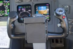 Control Wheel. View of control wheel and modern glass instrument panel from the pilot's seat stock images