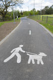 Control Your Dog behavioural sign. Marked on a shared path in a park royalty free stock image