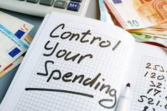Control your spending. Budgeting book and euros. Control your spending concept. Budgeting book and euros royalty free stock images