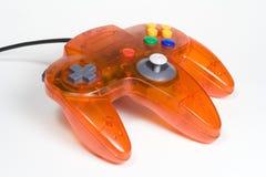 Controlador alaranjado do jogo video fotografia de stock