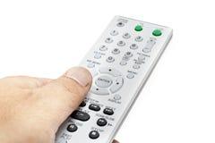 Controlador remoto com mão Foto de Stock Royalty Free