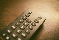 Controlador remoto da televisão por cabo com almofada do número fotos de stock