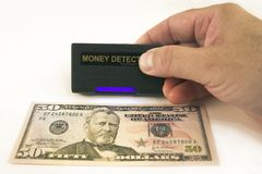 Controlar el dinero en circulación Fotografía de archivo libre de regalías