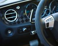 Controle botões no volante de um carro Fotos de Stock Royalty Free