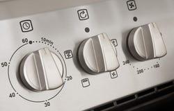Controles de una cocina moderna del acero inoxidable Foto de archivo