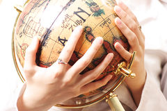 Controling. Retro globe in the hand Stock Photo
