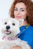 Controllare femminile con il cane Immagine Stock Libera da Diritti