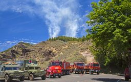 Controlled burn in Las Cumbres. LAS CUMBRES  DE GRAN CANARIA, SPAIN - May 21: , Military emergency unit and ambulances provides support at a controlled burn stock photography