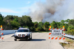 Controlled Burn Security. Nort Port Florida Police block a road which leads into a controlled burn area. These burns are common in FLorida to control the royalty free stock photo