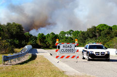 Controlled Burn Security. Nort Port Florida Police block a road which leads into a controlled burn area. These burns are common in FLorida to control the royalty free stock images