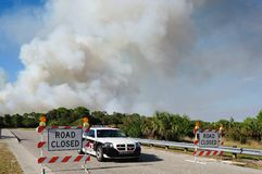 Controlled Burn Security. Nort Port Florida Police block a road which leads into a controlled burn area. These burns are common in FLorida to control the royalty free stock photos