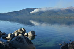 Controlled forest fire seen from Sand Harbor of Lake Tahoe Stock Image