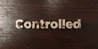 Controlled - grungy wooden headline on Maple  - 3D rendered royalty free stock image Stock Photography
