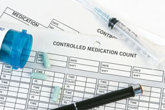 Controlled Medication Count. Controlled medication form with pen and prescription pills royalty free stock images