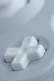 Controller Closeup. Macro shot of a video game controller directional pad Royalty Free Stock Photo
