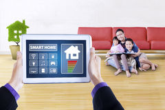 Controller icons of smart house and Asian family royalty free stock photo