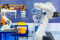 Controller of industrial robotic arm for performing, dispensing,. Material-handling and packaging applications in production line manufacturer factory Stock Photos