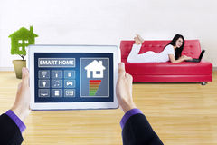 Controller of smart home and pretty woman Stock Photos