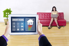 Controller of smart house on tablet Royalty Free Stock Photos