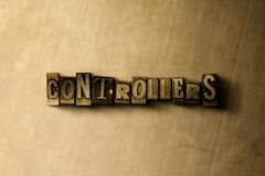 CONTROLLERS - close-up of grungy vintage typeset word on metal backdrop Royalty Free Stock Images