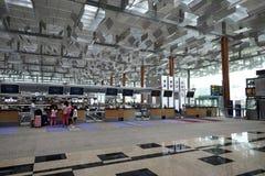 Controlli contro all'aeroporto di Singapore Fotografia Stock Libera da Diritti