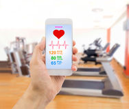 Controlling my exercise with a smartphone app Royalty Free Stock Photos