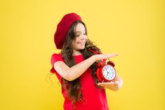 Controlling personal time. Define own rhythm of life. Schedule and time. Set up alarm clock. Child little girl hold red stock photography