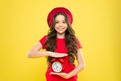 Controlling personal time. Everything is under control. Define own rhythm of life. Schedule and time. Set up alarm clock. Child little girl hold red clock stock photography