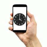 Controlling the time with my smartphone Stock Image