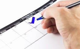 Controllo blu. Segno sul calendario al 25 dicembre 2013 Immagini Stock