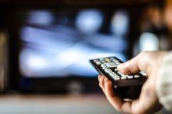 Controllo della TV nella mano Fotografia Stock