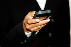 Controllo dello SMS Fotografia Stock Libera da Diritti