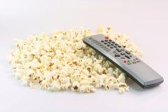 Controllo e popcorn Immagine Stock Libera da Diritti