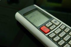 Controlo a distância condicional do ar do botão vermelho e 25 graus Celsius Foto de Stock