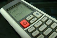 Controlo a distância condicional do ar do botão vermelho e 25 graus Celsius Fotos de Stock