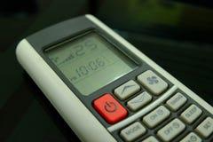 Controlo a distância condicional do ar do botão vermelho e 25 graus Celsius Imagens de Stock