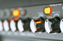 Controls of a guitar amplifier Stock Image