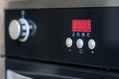 Controls on the oven Stock Images