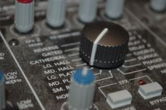 Controls on soundboard panel. Close up of controls on soundboard panel Royalty Free Stock Photo