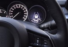 Controls on steering wheel and display of collision avoidance system in car. Buttons on steering wheel and display of collision prevention system in car royalty free stock image