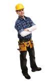 Contruction Arbeitskraft, die in der ernsten Haltung lächelt Stockbild