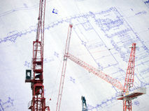 Contruction crane with blue print Stock Images